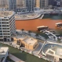 Orange colour in Dubai Marina water canal due to harmless construction material