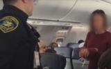 Photo: Flight diverted after woman tries to open emergency exit door