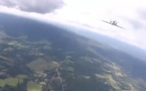 Photo: Fake video appears to show jet nearly colliding with parachute