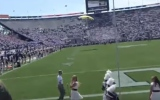 Photo: Parachute jumper crash lands into a wall at BYU-Wisconsin game