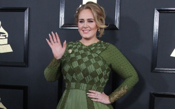 Photo: Adele to release upbeat track about divorce