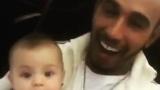 Photo: Lewis Hamilton 'sings' to bemused baby godson Darth Steve