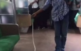 Photo: Snake on a train: Indonesian kills serpent with bare hands