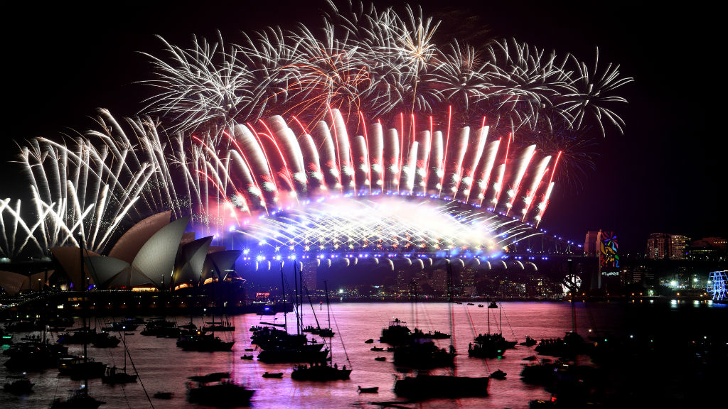 Fireworks light the sky over the Opera House and Harbour Bridge during New Year's Eve celebrations in Sydney early on January 1. (AFP)