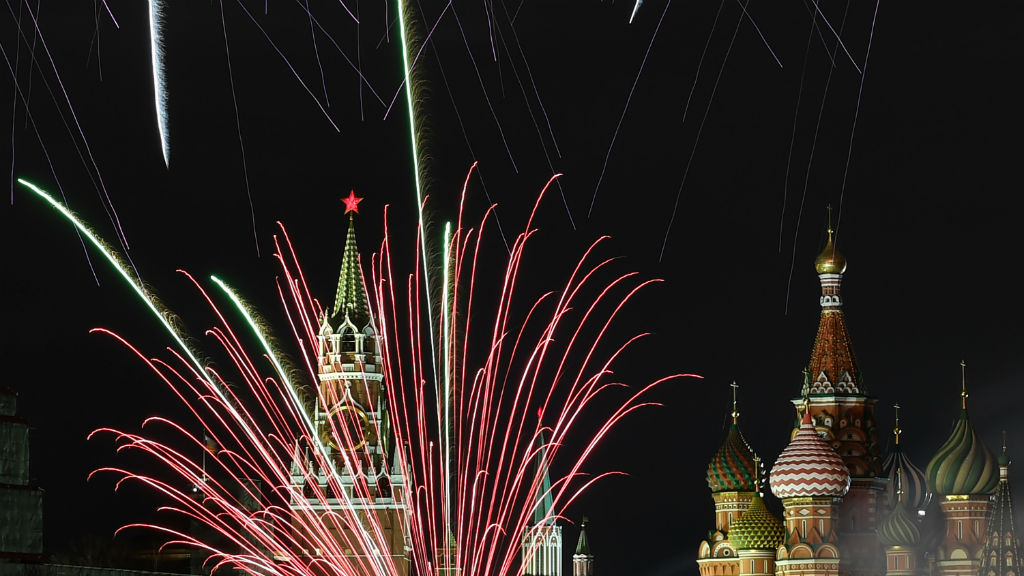 Fireworks explode over the Kremlin and St Basil Cathedral during New Year celebrations in central Moscow.(AFP)