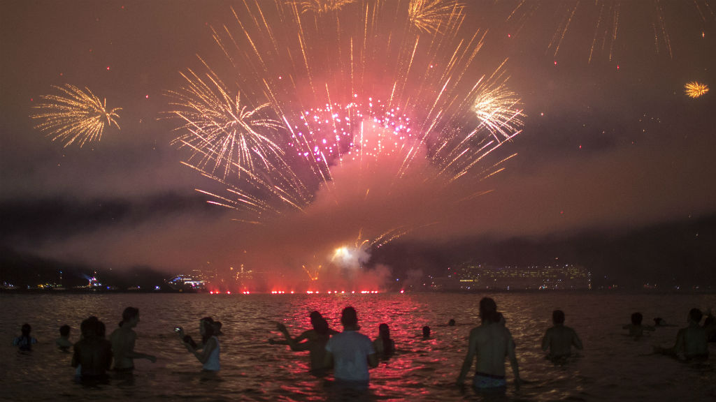 People watch fireworks during New Year's celebrations at Copacabana beach in Rio de Janeiro.(AFP)