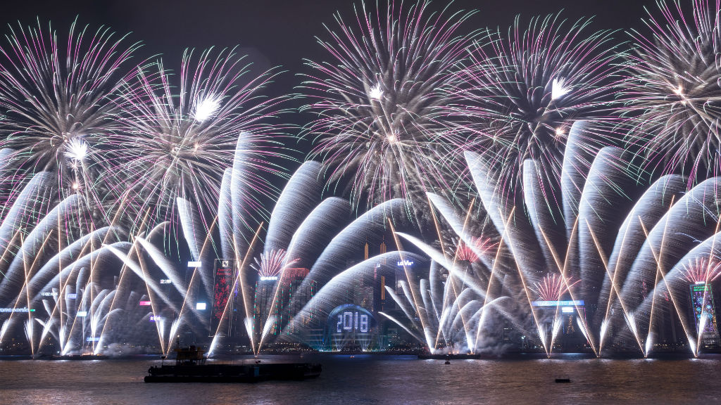 Fireworks explode over Victoria Harbour during New Year celebrations in Hong Kong.(AFP)