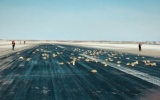 Photo: Gold spills on Russian runway after plane door glitch