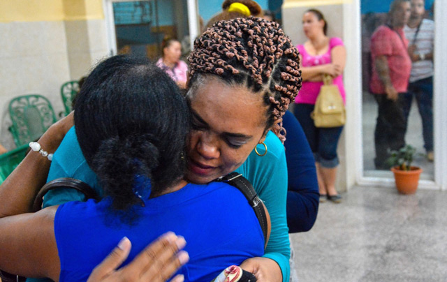 Relatives and friends of Norma Suarez Niles, a member of the Nazareno church who died in the plane crash in Havana that killed 110 people, comfort each other during the funeral in Holguin, eastern Cuba. (AP)
