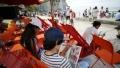 الصورة: Holiday reads: Beachgoers check out French seaside libraries