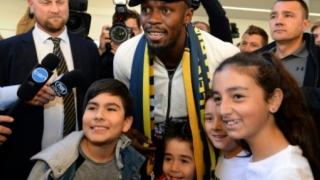 الصورة: Bolt arrives in Australia on football quest