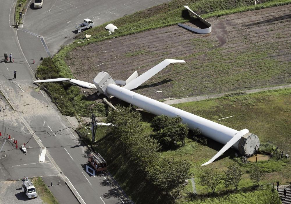 A windmill tumbles down at Hokudan Earthquake Memorial Park after Typhoon Cimarron hit Awaji, Hyogo prefecture, western Japan. (AP)