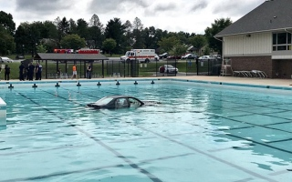 Photo: Driving lesson ends with car landing in a swimming pool