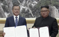 الصورة: Koreas agreed to disarm border village