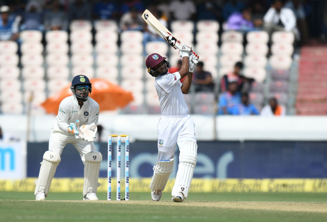 Indian wicketkeeper Rishab Pant looks on as West Indies cricketer Roston Chase plays a shot during the first day's play of the second Test cricket match between India and West Indies at the Rajiv Gandhi International Cricket Stadium in Hyderabad. (AFP)