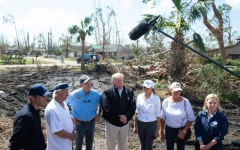 Photo: Trump questions climate change during hurricane damage tour