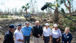 Photo: Trump questions climate change during hurricane damage tour