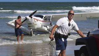 Photo: Small plane crashes off Florida beach, pilot survives