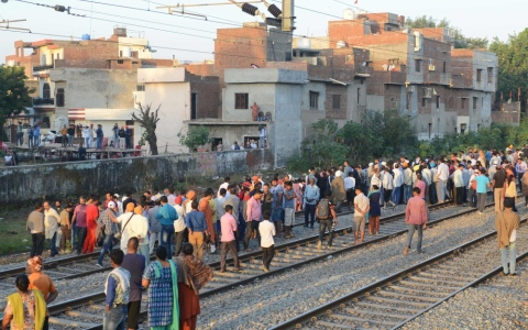 Photo: Train mows down crowd at India festival, at least 60 dead