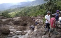 Photo: 4 rescued, at least 18 missing in Philippine landslide