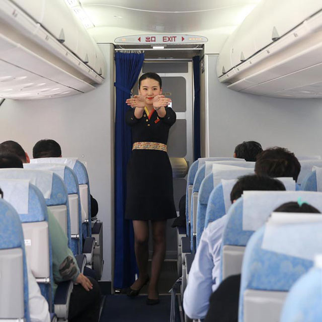 Air stewardess draws a window on paper to please complainer