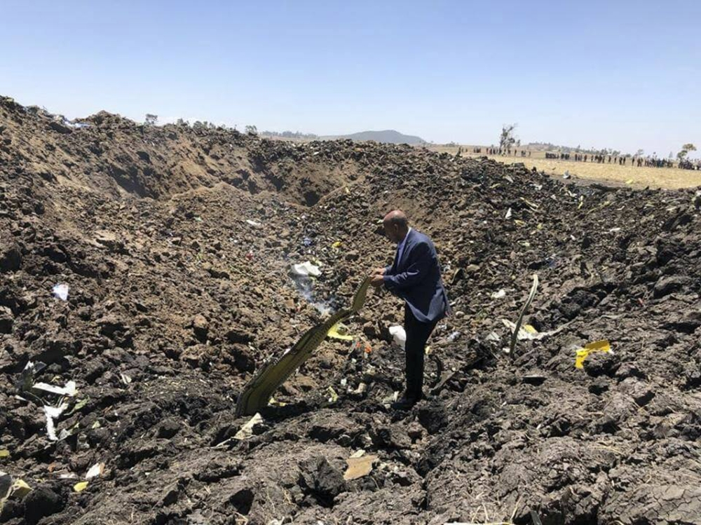 In this photo taken from the Ethiopian Airlines Facebook page, the CEO of Ethiopian Airlines, Tewolde Gebremariam, looks at the wreckage of the plane that crashed shortly after takeoff from Addis Ababa, Ethiopia, Sunday March 10, 2019. (AP)