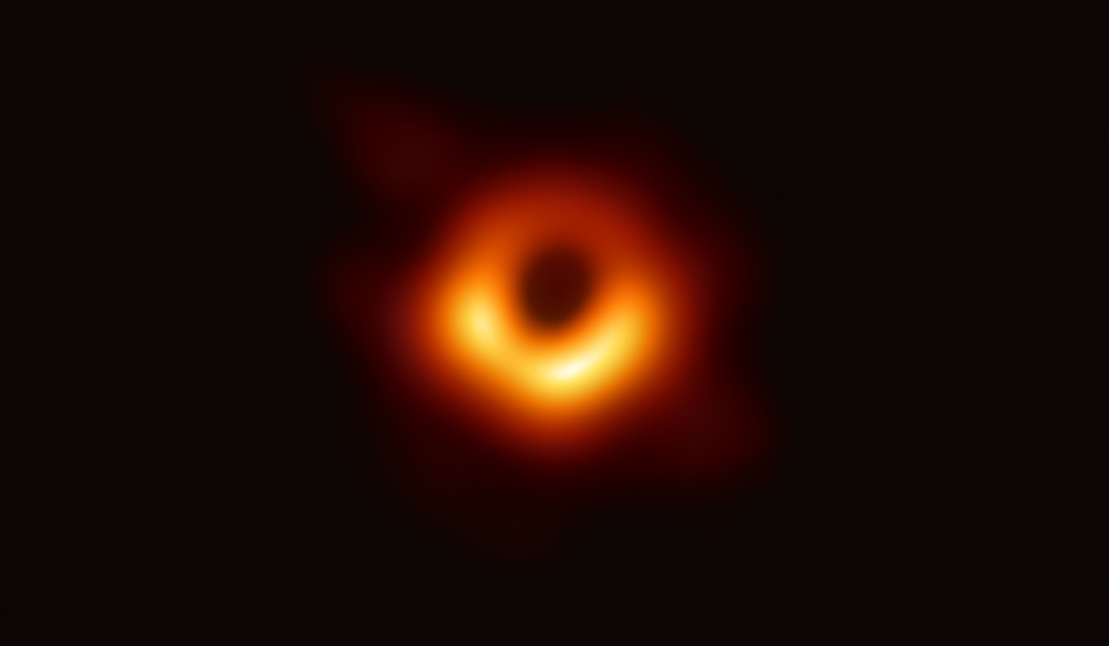 """A handout photo provided by the European Southern Observatory on April 10, 2019 shows the first photograph of a black hole and its fiery halo, released by Event Horizon Telescope astronomers (EHT), which is the """"most direct proof of their existence,"""" one of the project's lead scientists told AFP."""