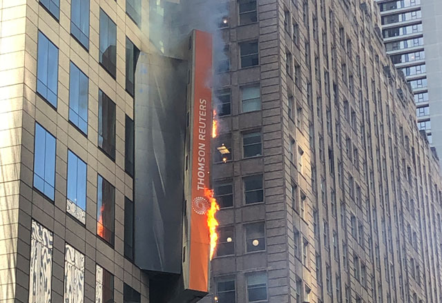Photo: Billboard in New York's Times Square catches fire