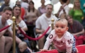 Photo: Lift those knees: Babies crawl to the Lithuanian finish line