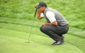 Photo: Woods 'fighting and hanging on' at US Open