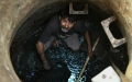 Photo: Seven die cleaning Indian hotel septic tank