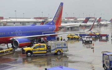 Photo: Truck hits parked plane, worker hurt