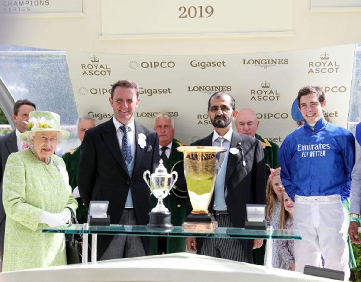 Photo: Mohammed bin Rashid receives trophy from Queen Elizabeth II on historic Royal Ascot win