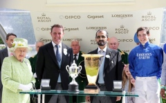 Photo: Mohammed bin Rashid receives trophy from Queen Elizabeth II on historic Royal Ascot win