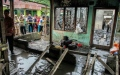 Photo: Two suspects in deadly Indonesian lighter factory fire probe