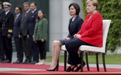 Photo: Germany's Merkel sits through anthems again