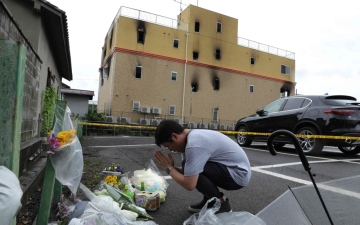 Photo: Japan 'hell' fire killed dozens trying to escape