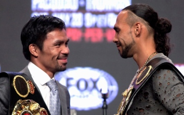 Photo: Pacquiao battling age, hungry Thurman in title showdown