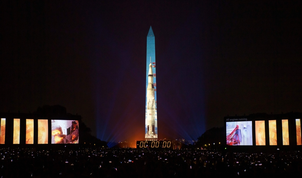 "50 year anniversary of the Apollo 11 mission being celebrated in the ""Apollo 50: Go for the Moon"" show, which combined full-motion projection-mapping artwork on the Washington Monument and archival footage to recreate the launch of Apollo 11, July 19, 2019 in Washington, DC. (AFP)"