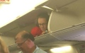 Photo: Southwest flight attendant climbs into compartment