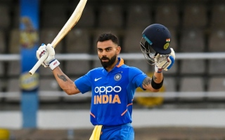 Photo: King Kohli leads India to victory and overshadows Gayle swansong