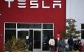 Photo: Tesla passes $100 billion, teeing up big payout for Musk