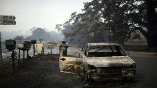 Photo: Man suspected of killing wife, three children in Australia fire