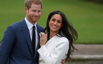 Photo: Britain's Prince Harry and Meghan to give up royal titles