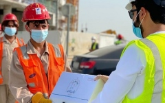 Photo: Municipality of Abu Dhabi City distributes Eid clothing to outdoor workers